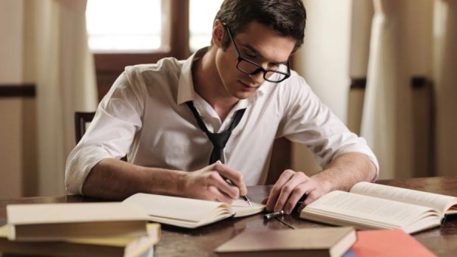 man-writing-books piccola